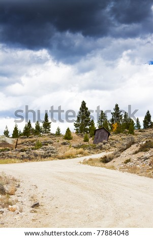 4 x 4 Road in Colorado at stormy weather - stock photo
