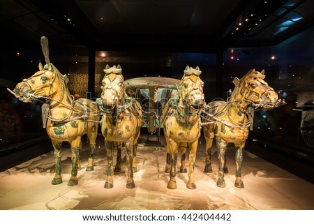 XIAN, SHANXI/CHINA-MAY 16: Emper Qin's Terra-cotta warriors and horses Museum on May 16, 2016 in Xian, Shanxi, China. The picture shows painted bronze car and horses. - stock photo