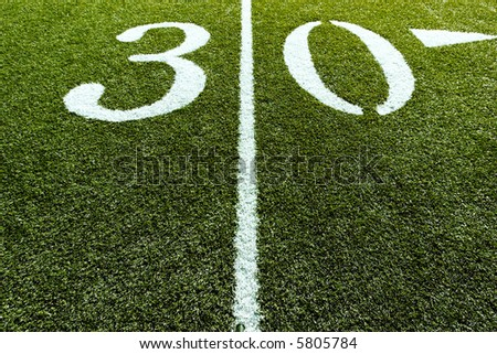30 Yard Line of Football Field with Line splitting the frame - stock photo