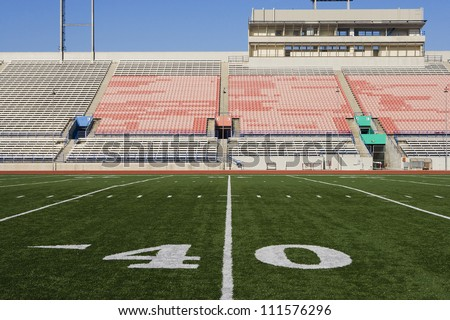 40 yard line on American football field with artificial turf - stock photo