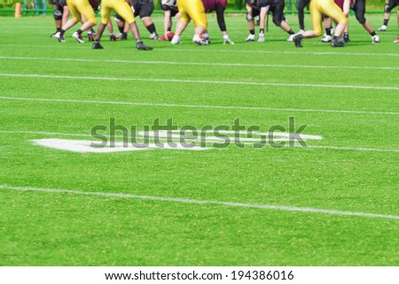 40 yard line with defocused players in the background.  - stock photo
