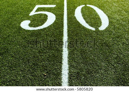 50 Yard Line with Line splitting the frame - stock photo