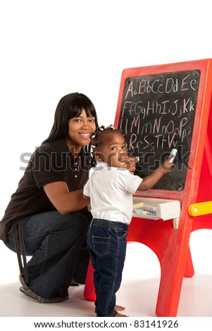 3 Year Old African American Girl and Mom Standing in font of Blackboard - stock photo