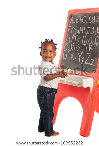 3 Year Old African American Girl Standing in font of Blackboard on Isolated White Background - stock photo