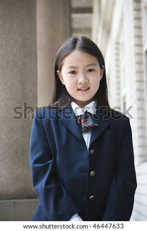 9-year old asian school girl in school uniform - stock photo