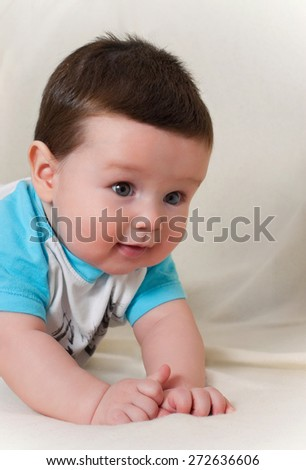 1 year old baby boy in T-shirt on light background - stock photo