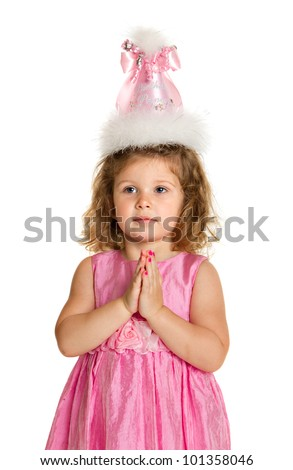 3 year old birthday girl with pink dress and hat make wish isolated on white background