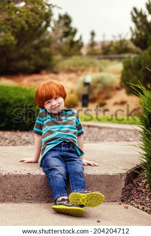 4 year old boy playing outside at a park -- image taken in Reno, Nevada, USA