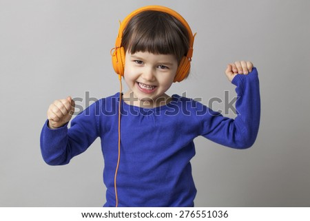 4-year old child dancing with rhythm and satisfaction - stock photo
