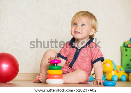 1,5 Year Old Child Playing With Educational Cup Toys At Home. Little