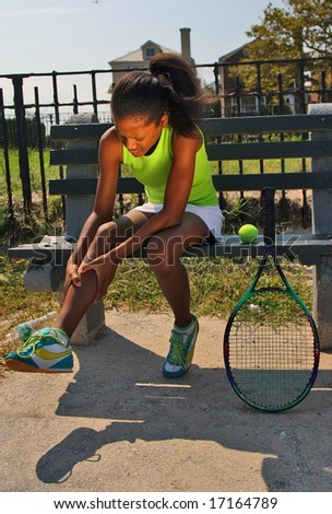 13 year old girl with knee injury from tennis game - stock photo