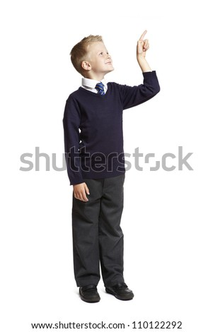 8 year old school boy pointing up on white background - stock photo