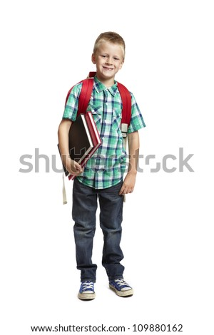 8 year old school boy with backpack holding books on white background - stock photo