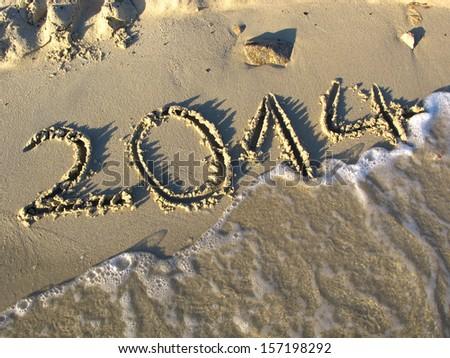 2014 year on the sand beach near the ocean - stock photo