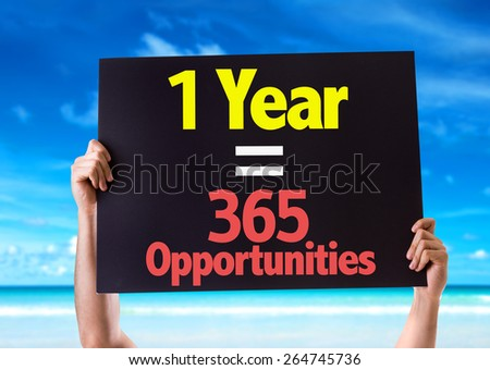 1 Year = 365 Opportunities card with beach background - stock photo