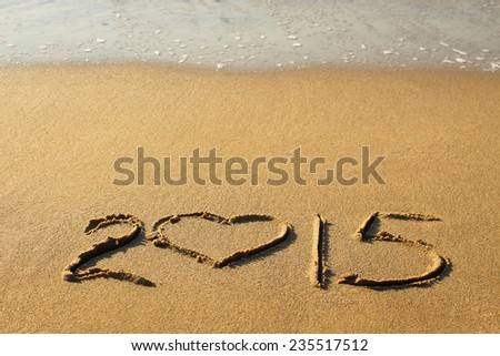 2015 year written on sandy beach. - stock photo