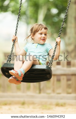 3 years baby on swing  in urban  park - stock photo