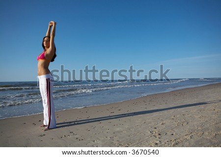 20-25 years old Beautiful Woman on the beach, during jogging