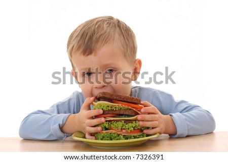 3-4 years old boy and big sandwich isolated on white