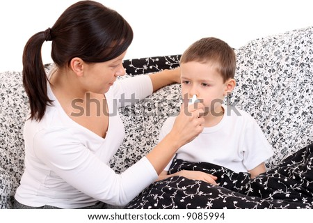 6 years old boy and his mother - flue season - stock photo