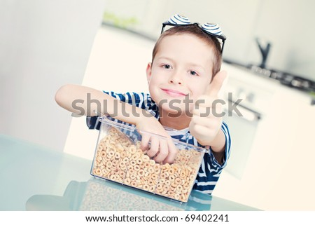 8 years old boy eating cereals - kids and family - stock photo