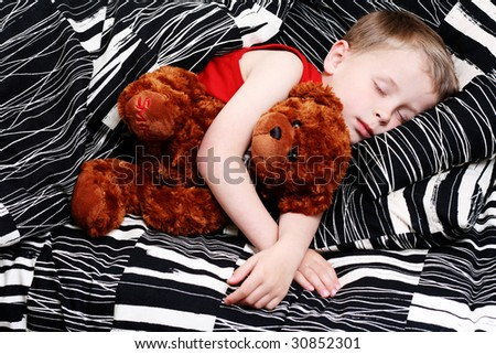 4-5 years old boy in bed - sleeping time - stock photo