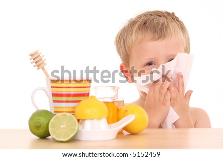 3-4 years old boy with cold and flu remedy on white - stock photo