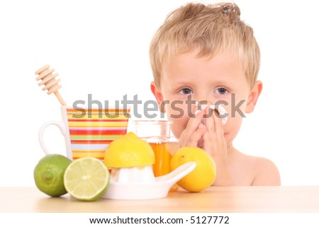3-4 years old boy with cold and flu remedy on white /focus on kid/ - stock photo