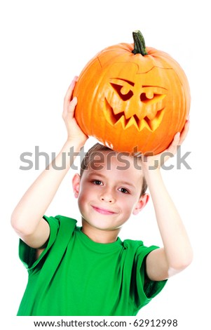 8 years old boy with Halloween pumpkin on white background - family and kids - stock photo