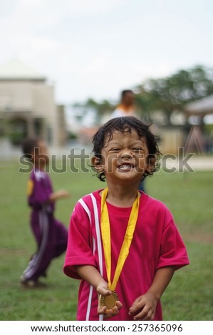 5 years old boy with his winning medal