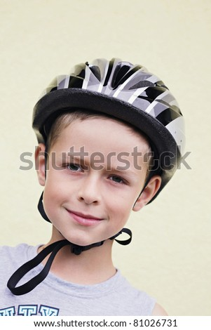 9 years old boy with safety helmet outdoor - kids and family - stock photo
