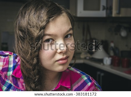 9-10 years old brunette girl in the interior of her room.  - stock photo