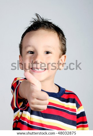 4 years old child doing a positive signal with his hand.ok attitude