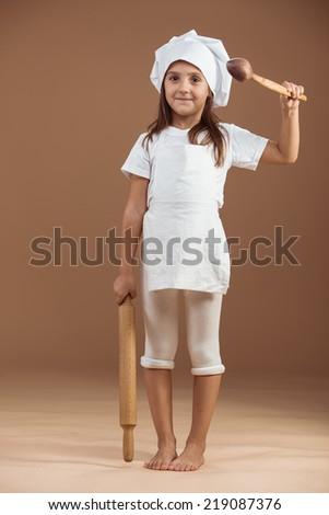 5 years old girl baker studio shot - stock photo