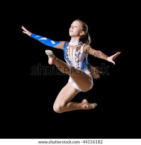 12 years old girl doing rhythmic gymnastics - stock photo