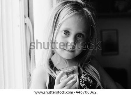 5 years old girl holding glass of milk - stock photo