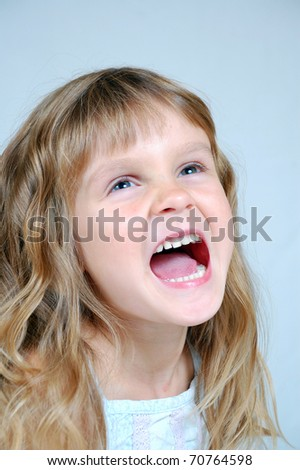 5 years old girl shouts with excitement. - stock photo
