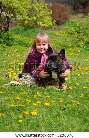 5 years old girl with french bulldog