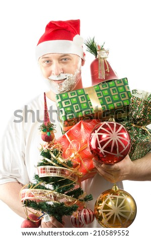 38 years old man wearing santa hat and holding  Christmas tree and gifts smiling and having beard from shaving foam white t-shirt  - stock photo