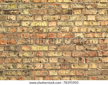 Yellow brickwork as a grunge wallpaper background - stock photo