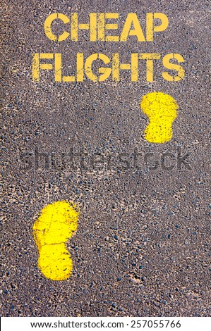 Yellow footsteps on sidewalk towards Cheap Flights, Travel conceptual image - stock photo