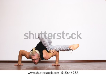 yogi in the hall in a pose, complex yoga postures, place for text