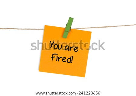 """You Are Fired"" Written on Sticky Note - stock photo"