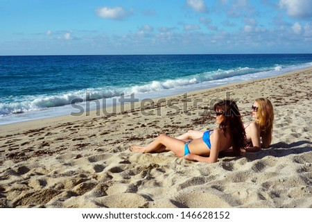 Young active women - girl friends on a beach, Italy  - stock photo