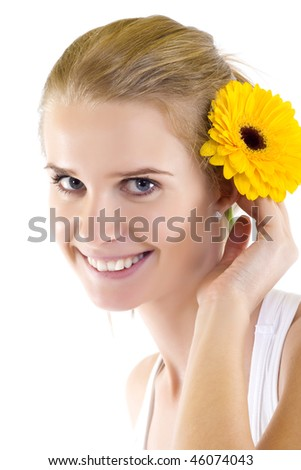 Young beautiful girl with flower over white