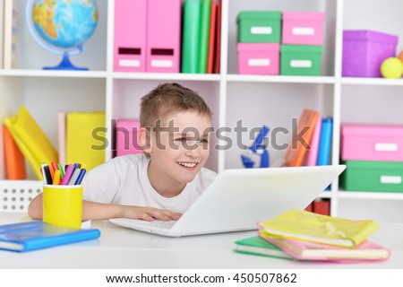 Young boy and  laptop computer