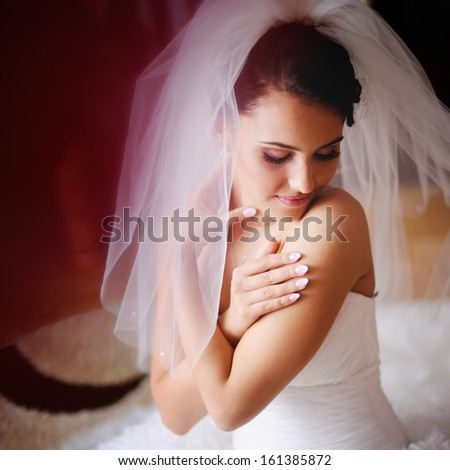 Young brunette bride in the morning at home.  Adorable fiancee. - stock photo