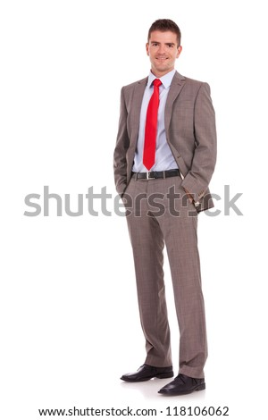young business man standing with his hands in the pockets - stock photo