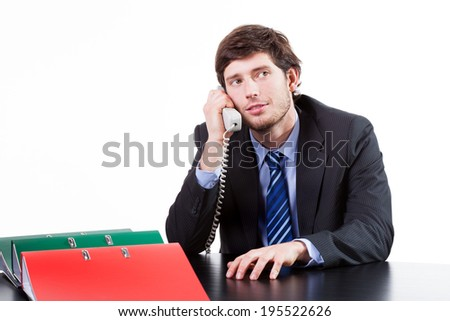 Young businessman calling phone with important customer
