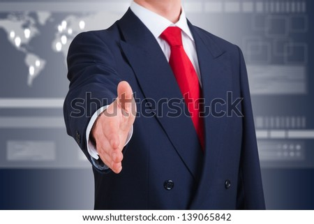 young businessman offering to shake hands against an high-tech interface. Clipping path included - stock photo